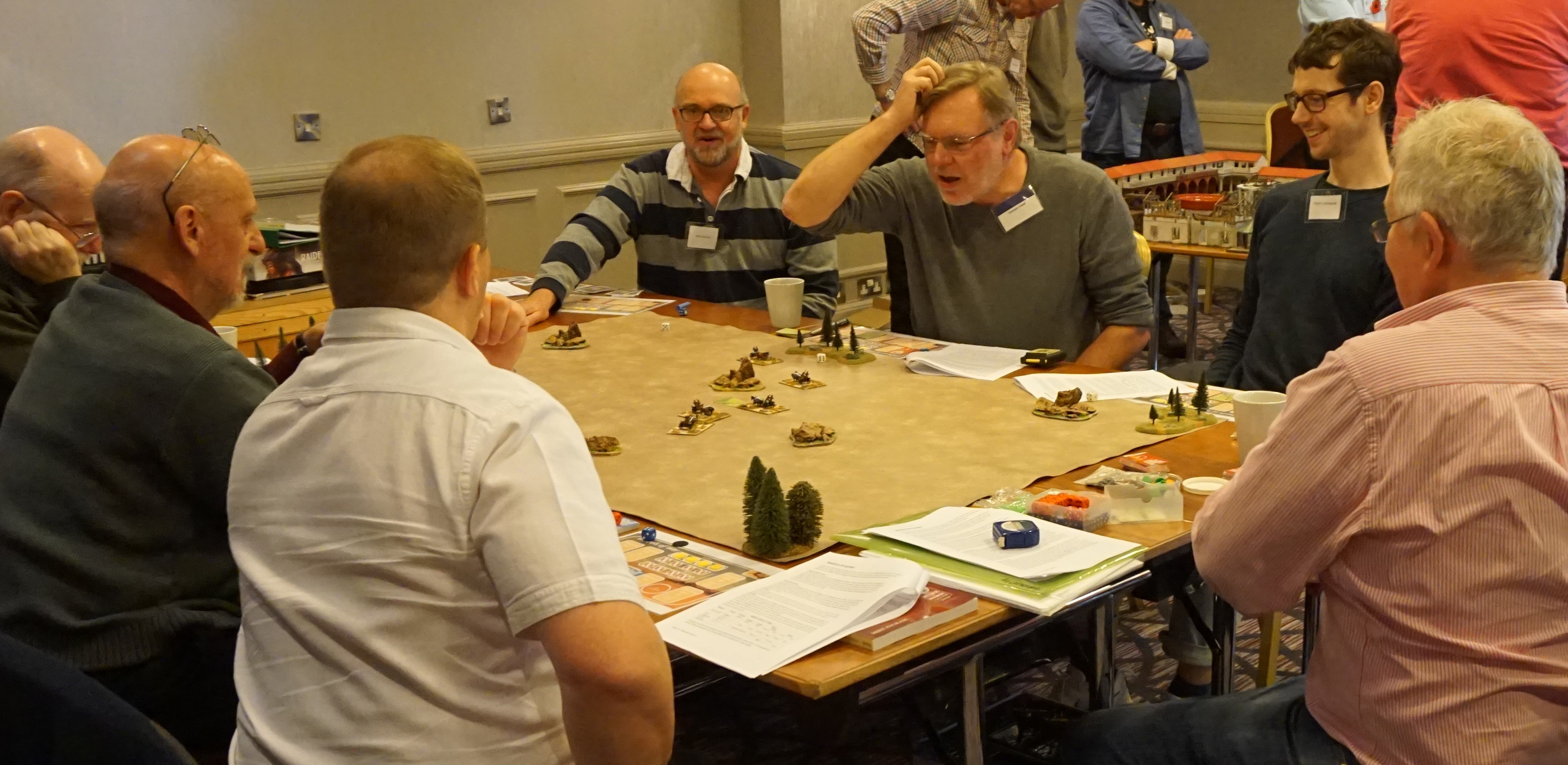 Duncan Head clutching his head over a wargaming table